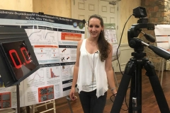 Aubrey presenting a 30-second research pitch to camera at the 2016 Chemistry Department Retreat.