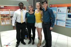 Jessica and Aubrey (center) pose with summer undergrads Brian and Daniel during their final poster session.